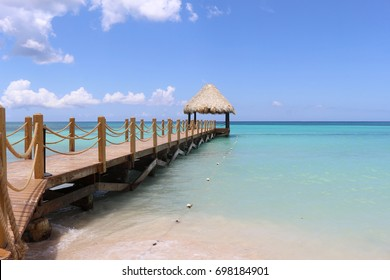 Wooden dock and shore at Bayahibe beach, Dominican Republic