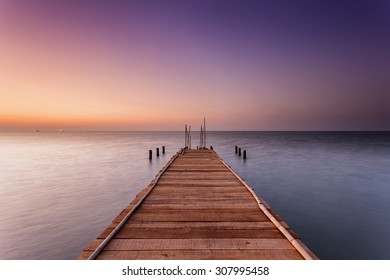 Wooden Dock at Sunset. Pemalang, Central Java, Indonesia.