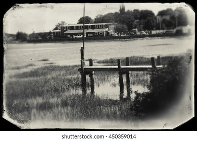 Wooden dock at Wellfleet, MA on Cape Cod in black and white