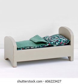 Wooden doll bed