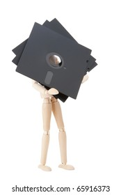 Wooden doll carries data storage media,  5.25 inch floppy