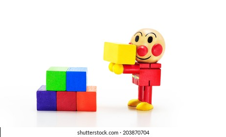Wooden doll with cubic