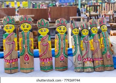 Wooden dolls, handicrafts on display during the Handicraft Fair in Kolkata. It's the biggest handicrafts fair in Asia.