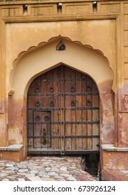 Wooden door of Amer Fort in Jaipur, India.