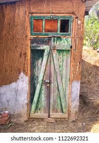 Wooden door of a barn in Tizi Ouzou, Algeria.