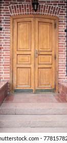 wooden door in a brick house