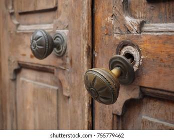 Wooden door with broken handle.