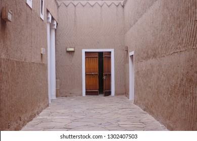 Wooden door built into mud wall - Old traditional wooden door