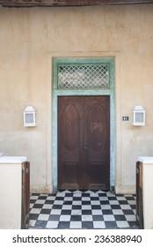 Wooden door and checkerboard floor