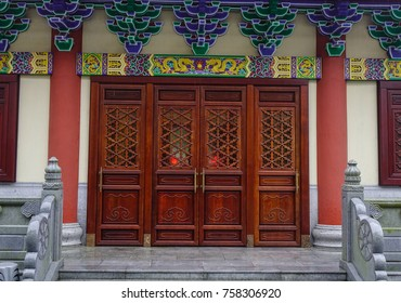 Wooden door of a Chinese temple in Kowloon District, Hong Kong.