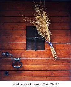 Wooden door with eyebrow charm