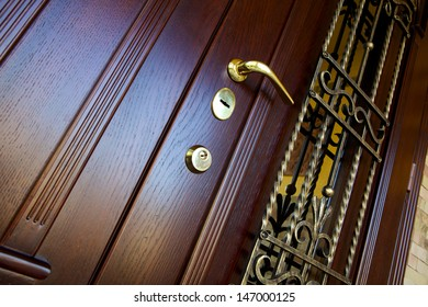 wooden door with forged metal grate