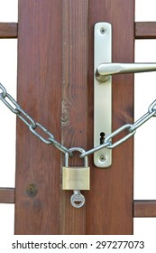 Wooden door of a garden house secured with an extrachain chain