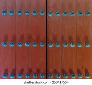 Wooden door of Geyongbokgung Palace at night in Seoul, South Korea.