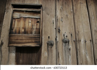 Wooden door with handmade postbox