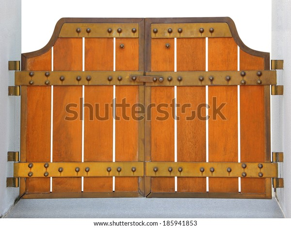 Wooden door with iron elements isolated on white background
