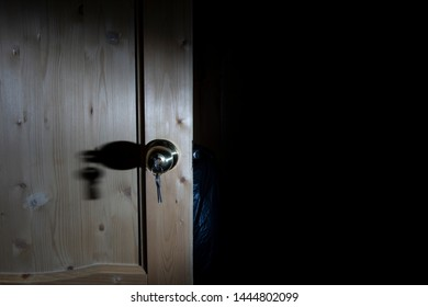Wooden door with lock and keys. Close-up photo.