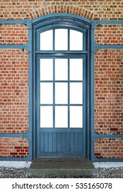 Wooden door with metal frame in a brick wall