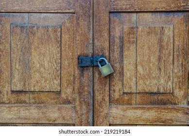 wooden door with metal lock