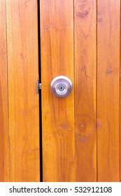 Wooden door with modern Door Handle.