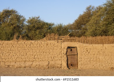 Wooden door and mud wall at Dakhla oasis, Egypt