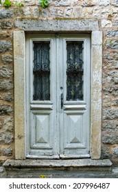 Wooden door in old house in Budva, Montenegro