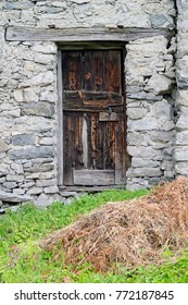 Wooden door of an old house in a mountain village in the Alps