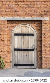 wooden door on the brick wall