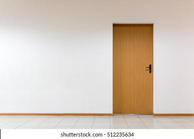 Wooden door on a clean wall indoors