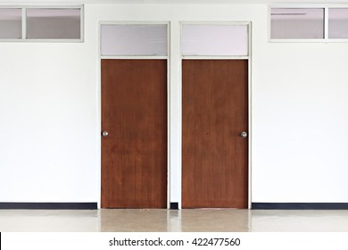wooden door on  white   walls.