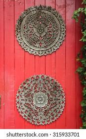 Wooden door overgrown with ivy