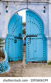 Wooden door painted in blue in Chefchaouen, Morocco. Xauen, Chaouen.
