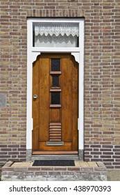 Wooden door part of a home, Netherlands, Europe