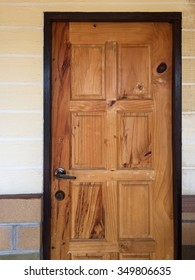 Wooden door set in a wall