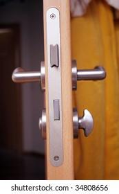 wooden door with silver doorhandle at home
