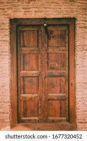 Wooden Door in a Small Village