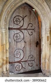Wooden door and stone arch to a Medieval English Abbey