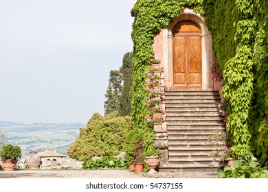 A wooden door and stone steps of a house