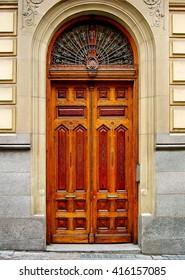 Wooden door in the street of Madrid, Spain