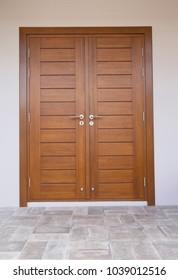 Wooden door with tiled floor