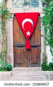 Wooden door with Turkish flag