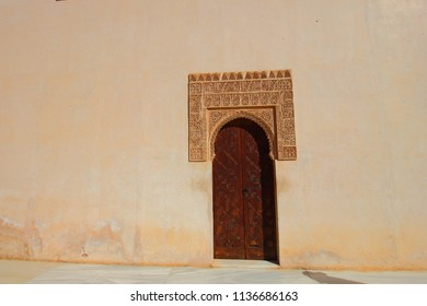 The wooden door which is an entrance to the bathhouse of the Comares Palace or Palacio de Comares in Alhambra Palace and Fortress Complex in Granada, Spain.