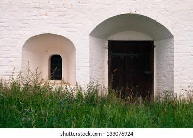 Wooden door and window bars.