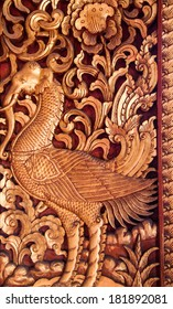 Wooden doors carved into lotus, decorated with stained glass, Thai Art.