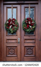 Wooden Doors with Christmas Wreaths