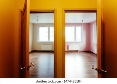 Wooden doors installation at new interior apartment. Apartment renovation. Interior detail of modern flat.