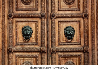Wooden doors with lion heads