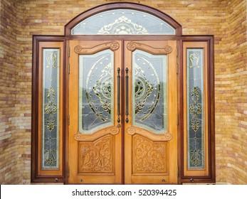 Wooden doors on bricks wall. wood door background