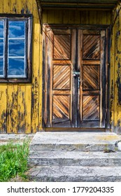 Wooden doors in timber building. Abandoned and decrepit church architectonic details. Chotylub village, Poland, Europe.