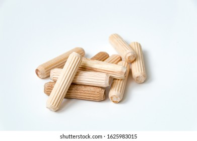 Wooden dowels on white background for connection on chipboards.